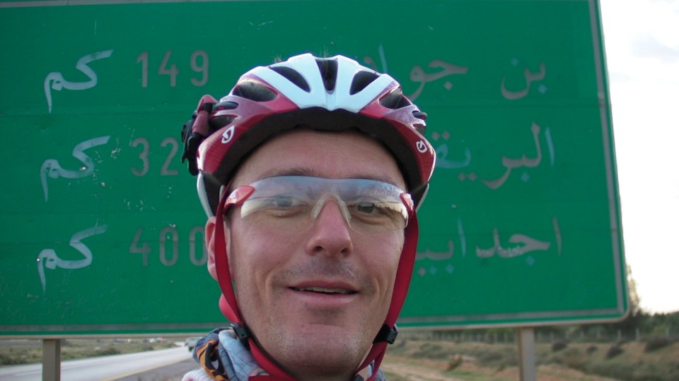 Vin Cox and the sign to Bin Jawad and Ajdabiya, Libya