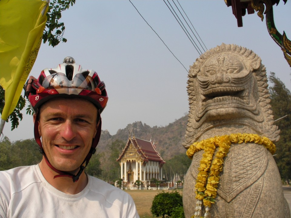 Vin Cox enjoying a typical Thai view of a Buddhist Wat (temple).