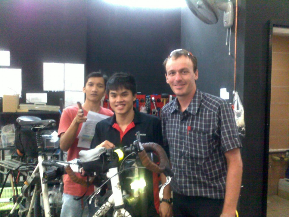The staff at Rodalink Singapore prep Vin Cox's bike for Sumatra