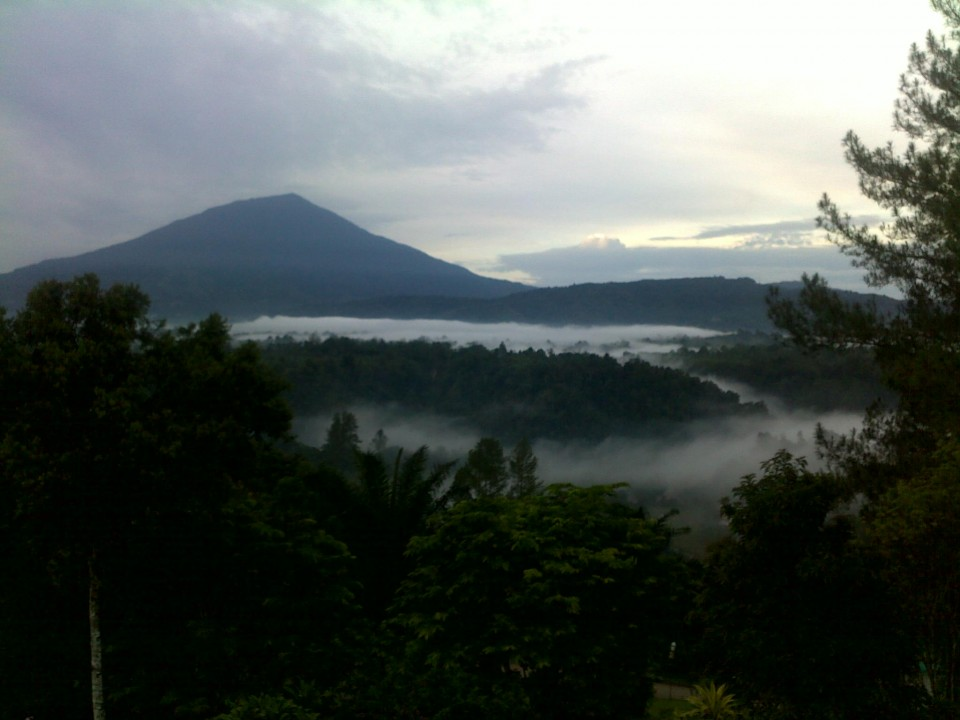 The morning view over Bukittinggi to the volcano from the hotel.